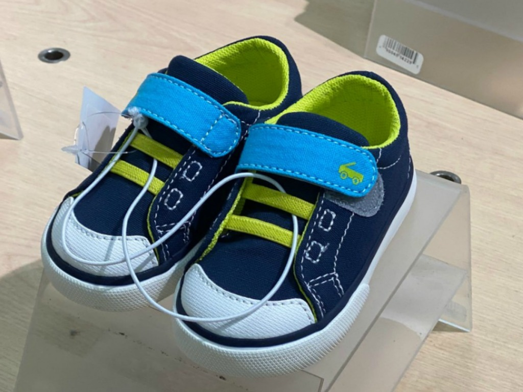 Toddler boys velcro slip on shoes in navy blue on display in-store