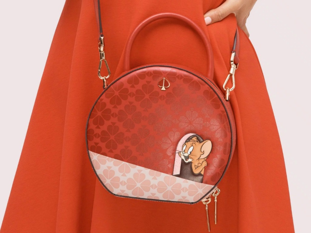 Woman wearing a red dress and a red handbag with Tom & Jerry Character printed on the front