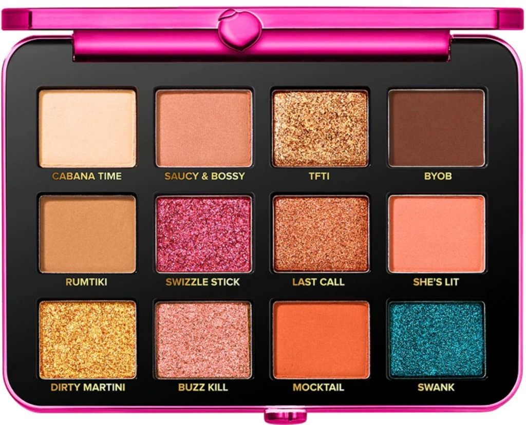Large eyeshadow palette with a variety of colors and glitters