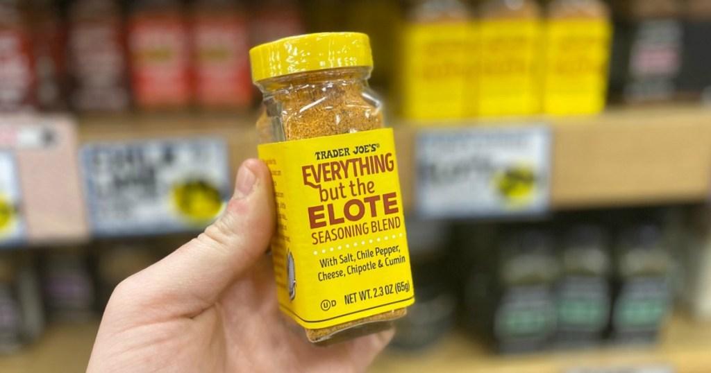 man holding Trader Joe's Everything but the Elote seasoning