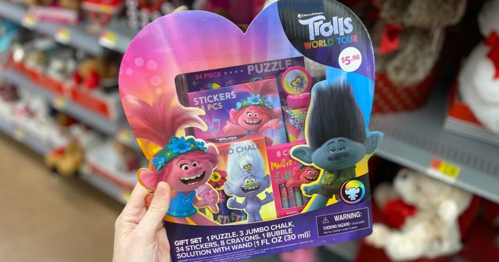 woman holding Trolls Valentine gift set for kids