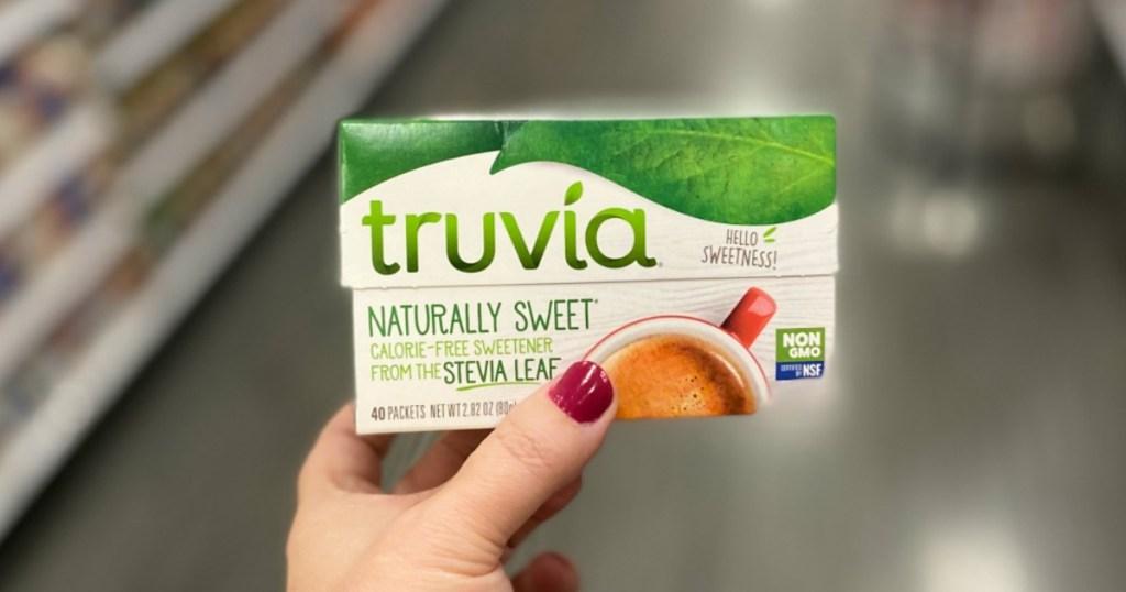 Woman's Hand holding Truvia Sweetener