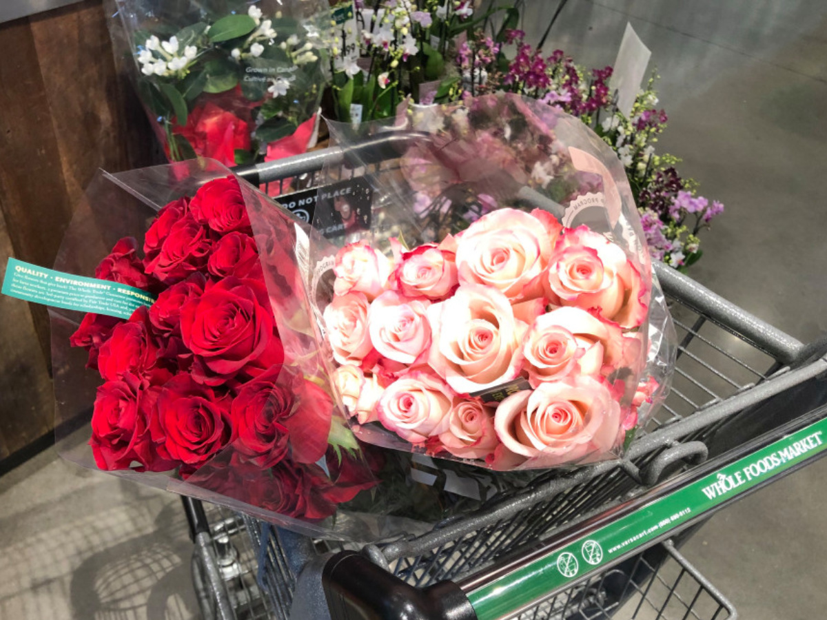 red and pink roses bunches in whole foods shopping cart