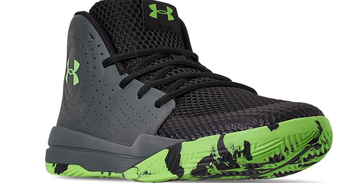Grey and green under armour high top sneaker. Front side view of the right shoe.