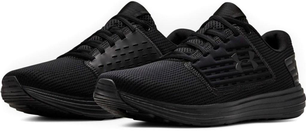 Pair of men's all-black running shoes