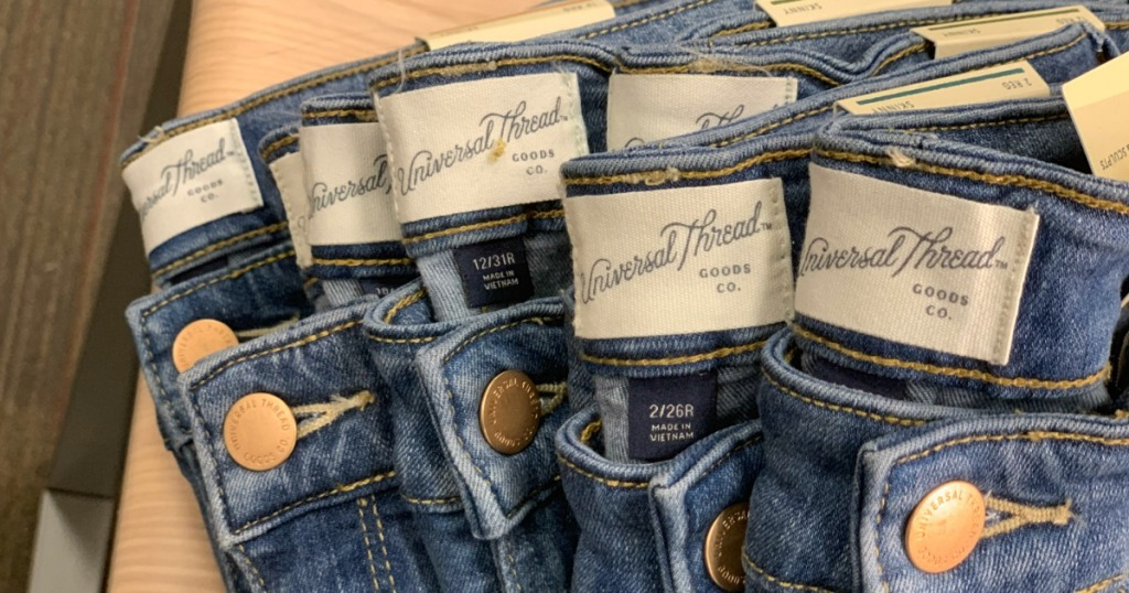 pairs of Universal Thread Jeans folded with tags showing