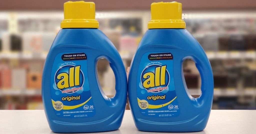 two bottles of laundry detergent on a shelf at store
