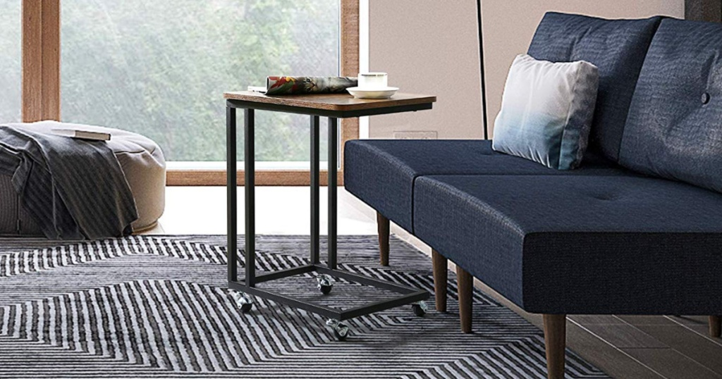 living room with mobile side table by blue couch