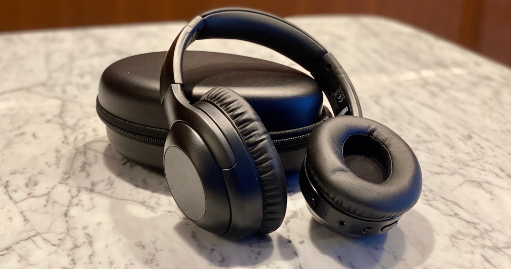 pair of headphones sitting on case on counter