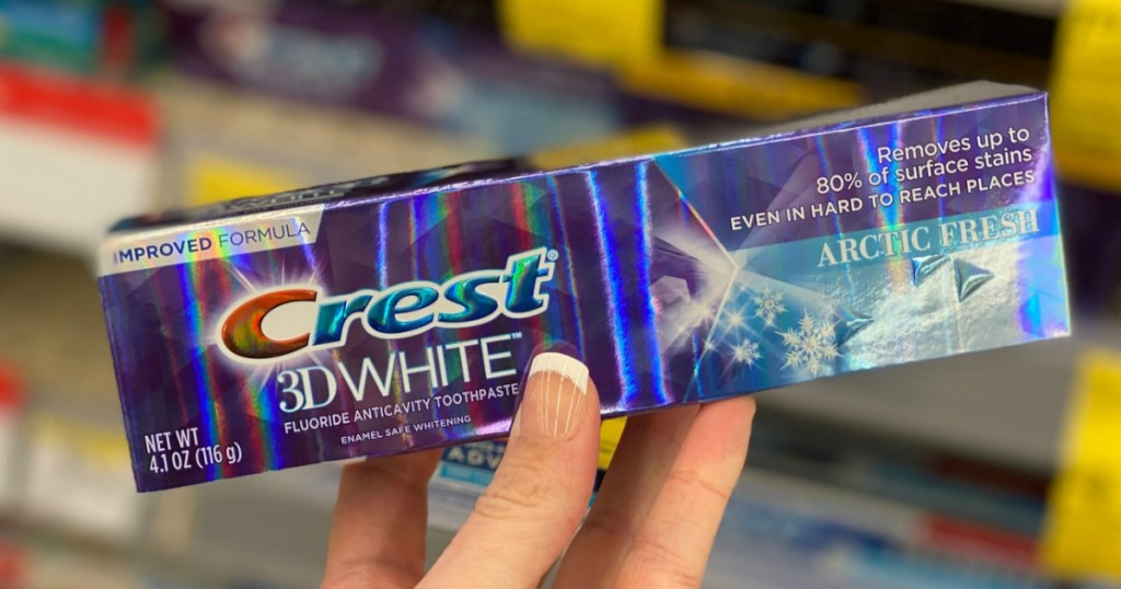 Walgreens toothpaste in hand in package near in-store display