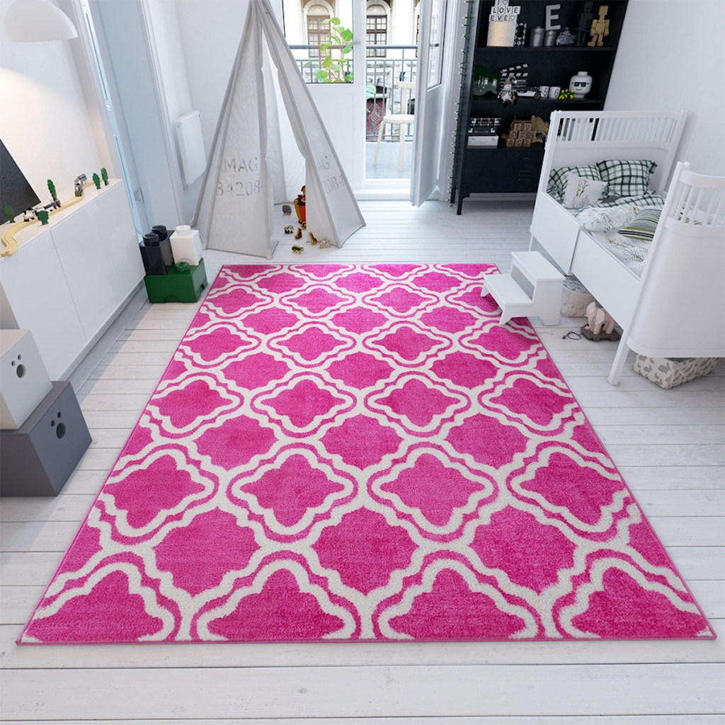 Well Woven Pink Calipso Star Bright area rug in room with white decor