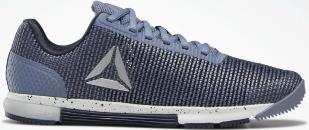 Blue women's training shoe on white surface