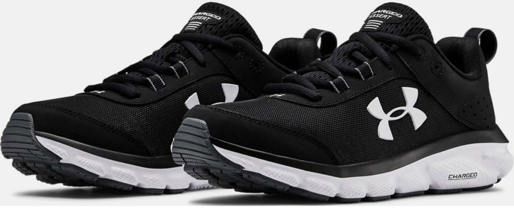 Pair of Women's Under Armour running shoes in black with white soles