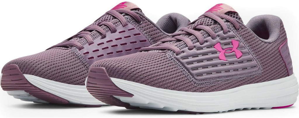 Pair of purple women's running shoes with white sole and pink laces
