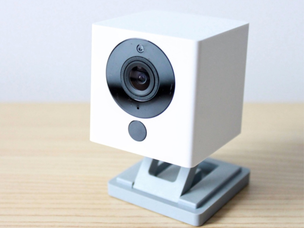 White indoor smart camera on table