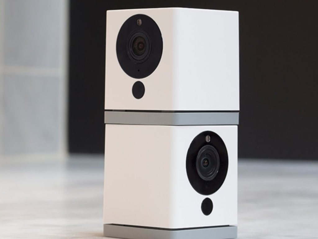 Two white indoor smart cameras