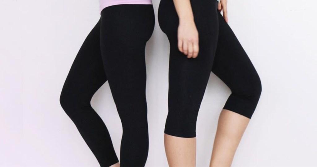 Two women wearing Yummie brand leggings