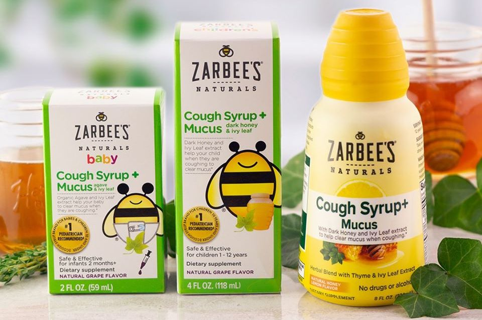 Zarbee's Naturals cough products for baby, toddler and adults on a counter