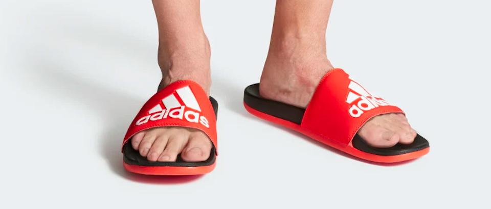 pair of feet wearing adidas sandals