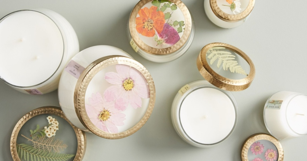 assortment of Anthropologie floral press candles