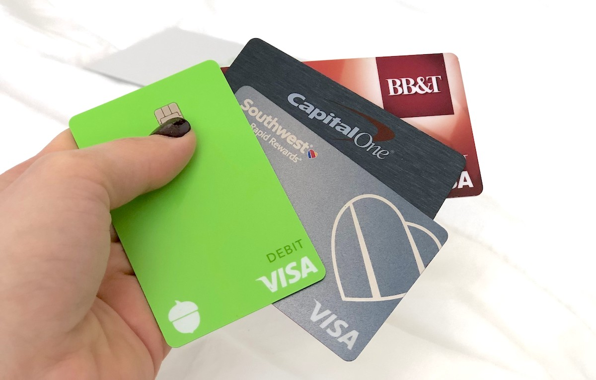 hand holding 4 different bank visa cards