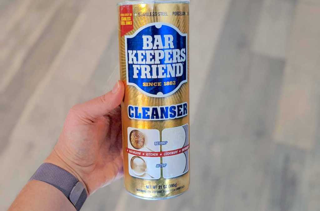 hand holding a bottle of bar keepers friend