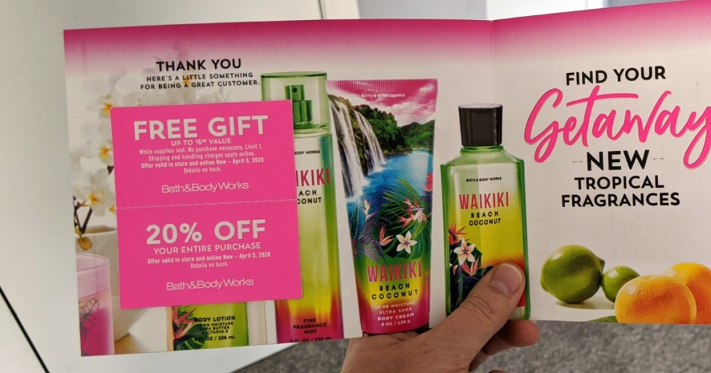 hand holding bath and body works coupons