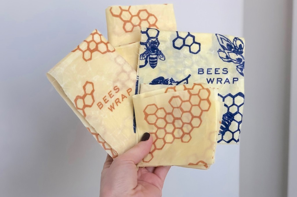 hand holding yellow and blue bees wraps
