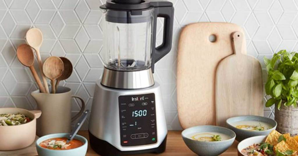 Instant Pot Ace 60 Cooking Blender on a kitchen counter with soups