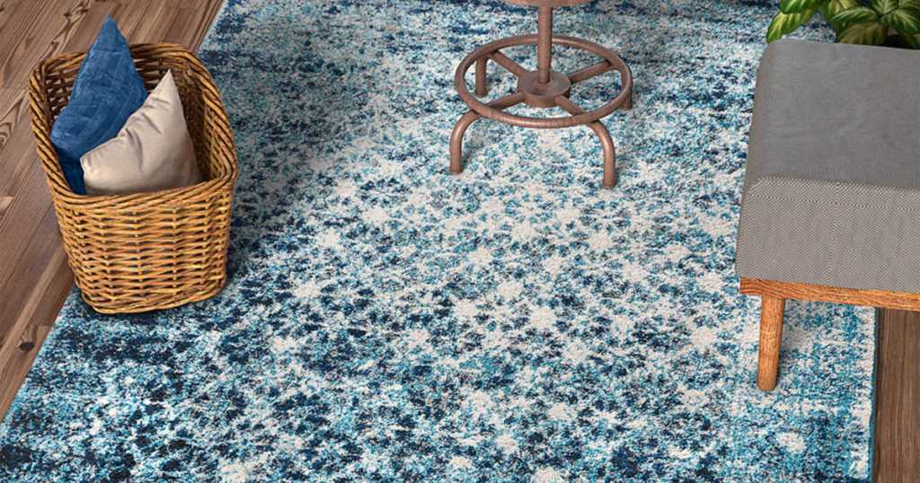 blue, light blue, and white rug with chair and basket on top