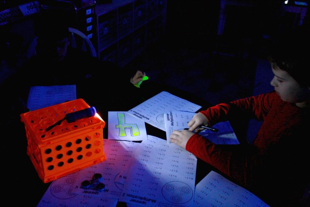 boy playing math game in dark