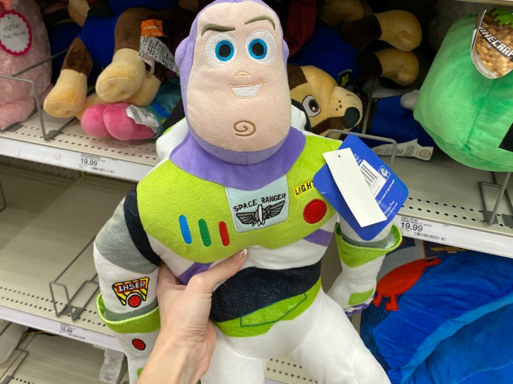 hand holding stuffed toy called Buzz