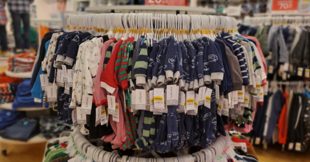 carters baby pajamas hanging on rack in store