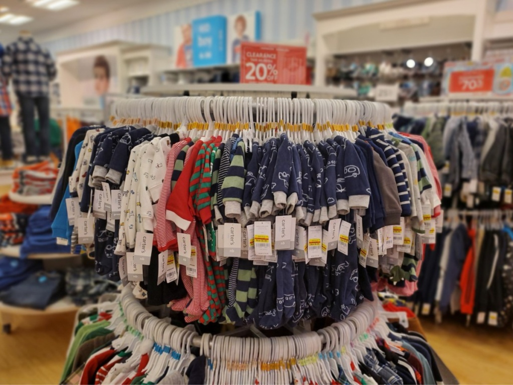 carters baby pajamas on rack in store