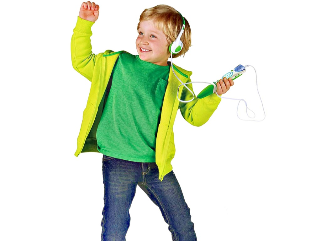 child listening to his LeapFrog LeapReader Reading and Writing System