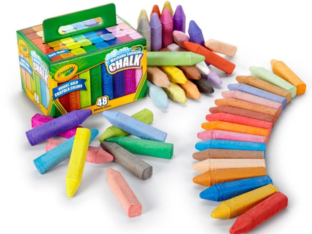 crayola sidewalk chalk box and chalk strewn about