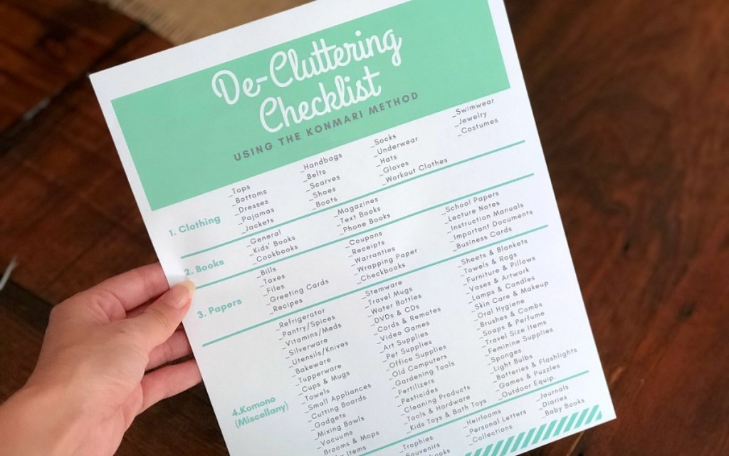 hand holding a decluttering checklist