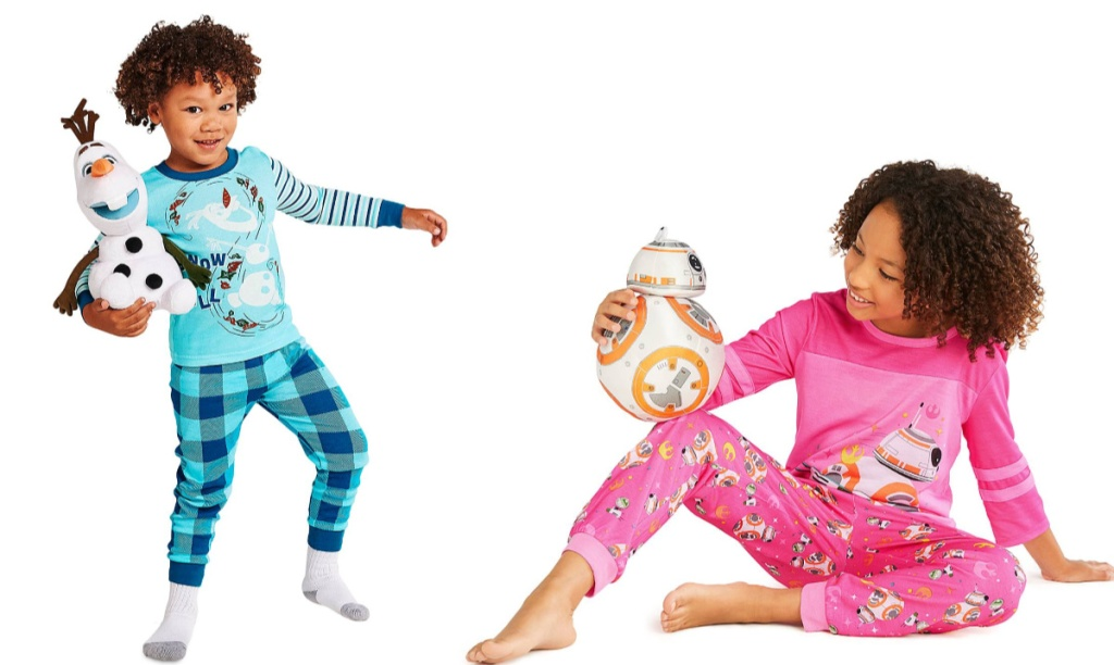 boy earing blue plaid olaf pjs holding stuffed olaf and girl wearing pink star wars pjs holding bb-8
