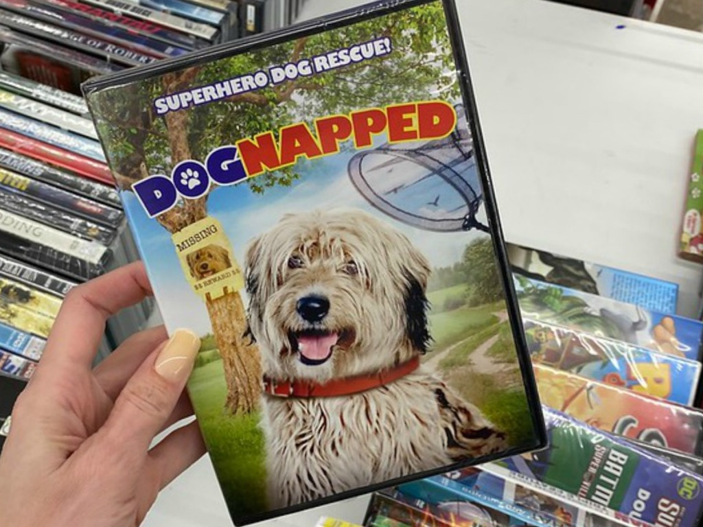 hand holding DVD with dog's face on it
