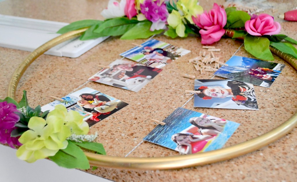 gold hula hoop with colorful florals and pictures in middle