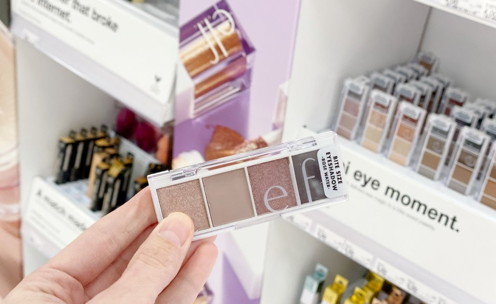 hand holding an eyeshadow pallet in store