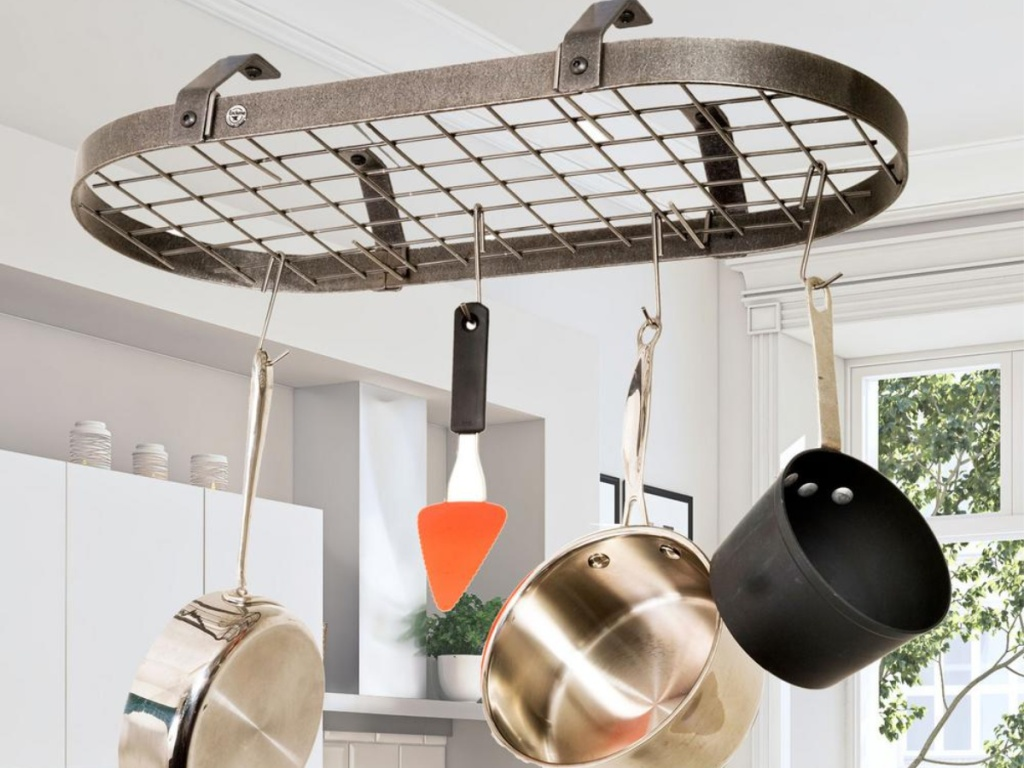round pot rack holding pans pots and utensils in kitchen
