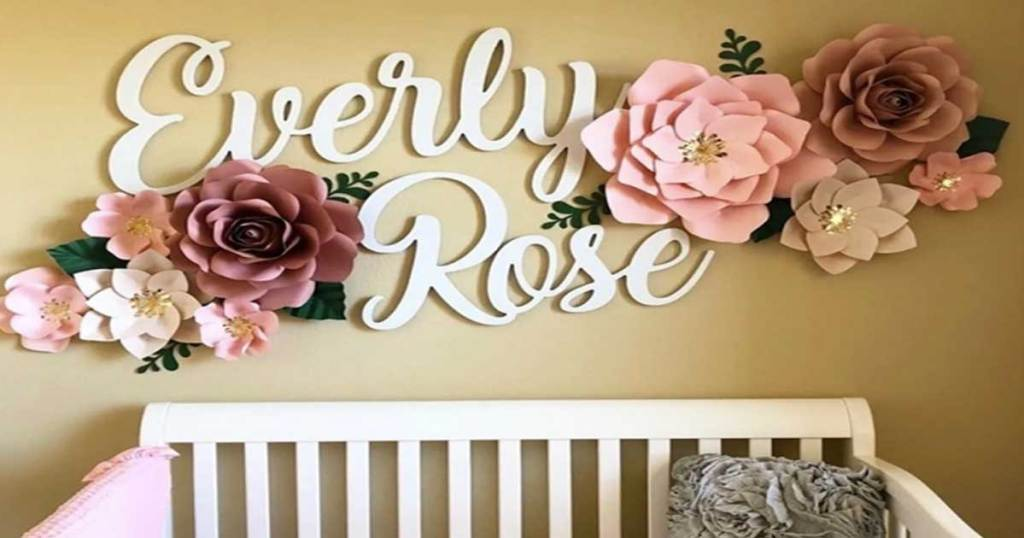 baby first and middle name sign on the wall in a nursery
