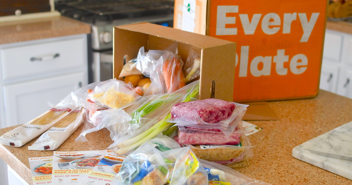 orange every plate box with various types of packages food overflowing on counter
