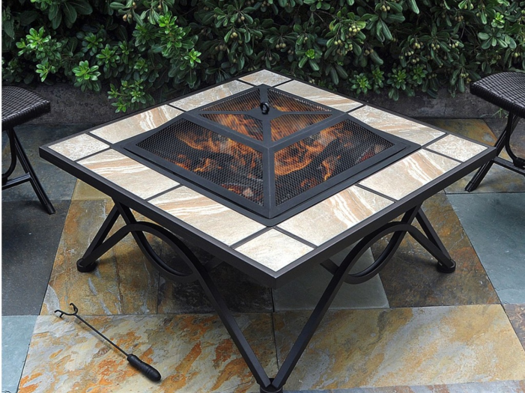 Ceramic Tile Fire Table with lit flame outside