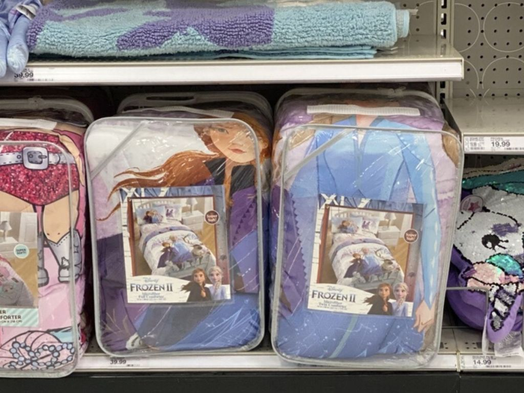 store shelf with packaged brand new comforters