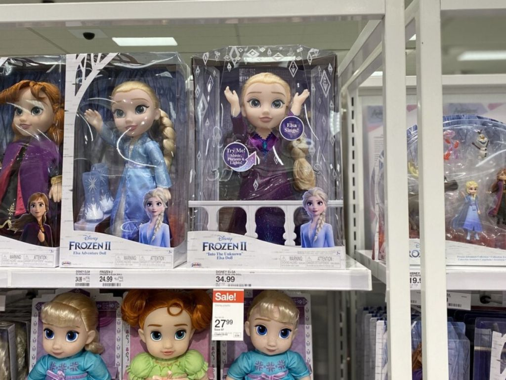 top shelf at store with dolls inside boxes