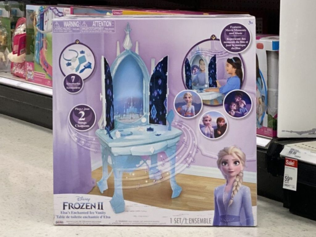 cardboard box containing childrens vanity toy on floor at store