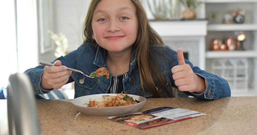 girl giving thumbs up to a gobble meal