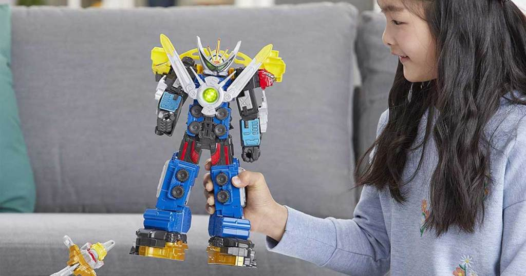 girl playing with power rangers ultrazord toy
